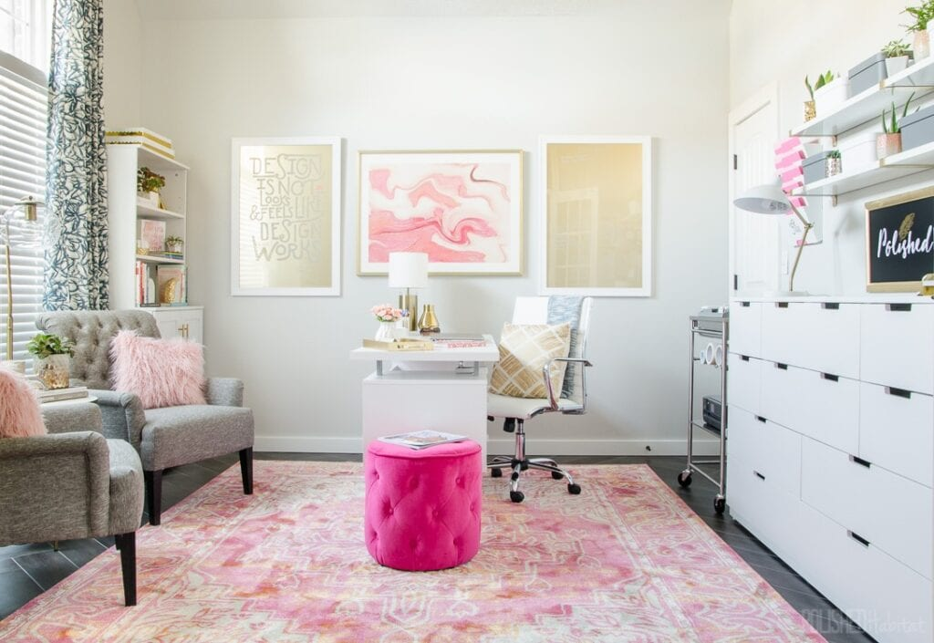 home office brightened up with white painted walls, white furniture, and bright pops of color