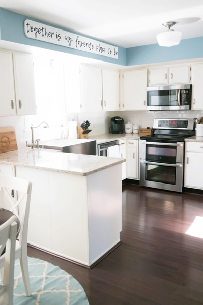 example of how to brighten a dark kitchen: dark cabinets have been painted white