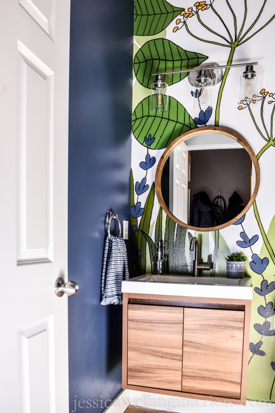 finished DIY accent wall botanical mural with wood vanity and mirror