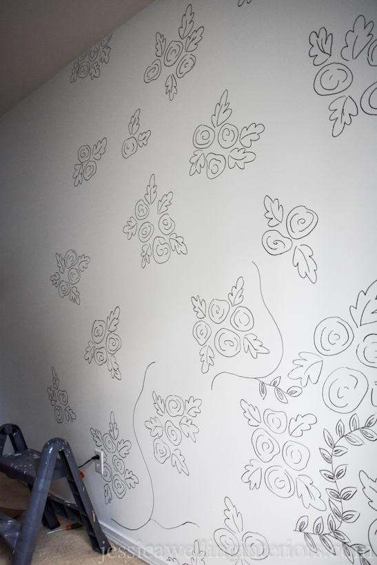 large wall with bunches of roses spaced out to look like a wallpaper print