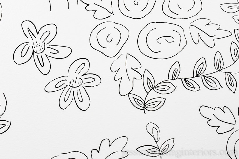 close-up of floral print drawn on wall to look like wallpaper