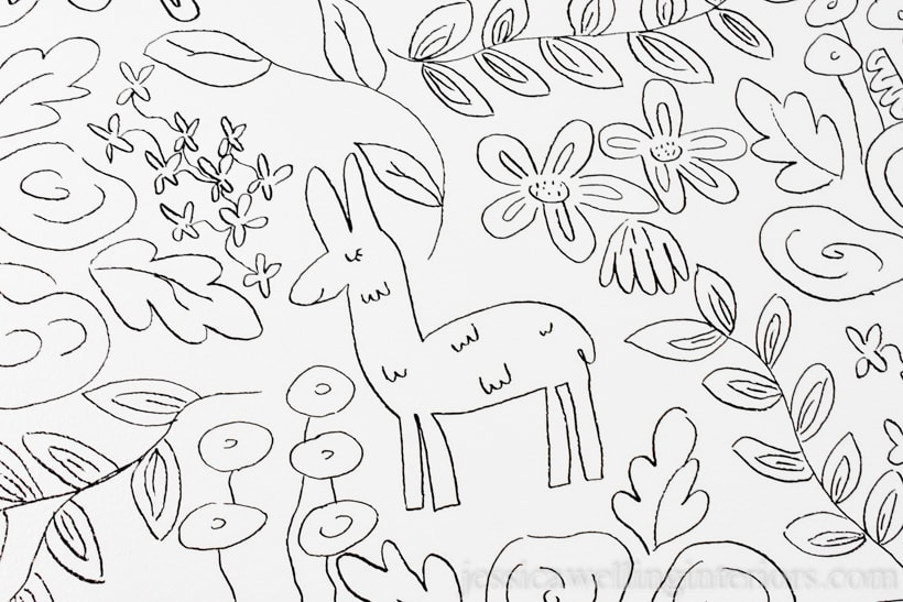 close-up of black and white floral print drawn on wall with an alpaca in a DIY wall mural