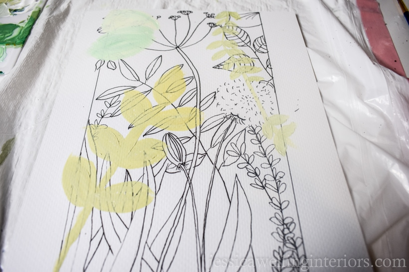 line drawing of plants and flowers with leaves painted over it as part of the planning process for a DIY wall mural