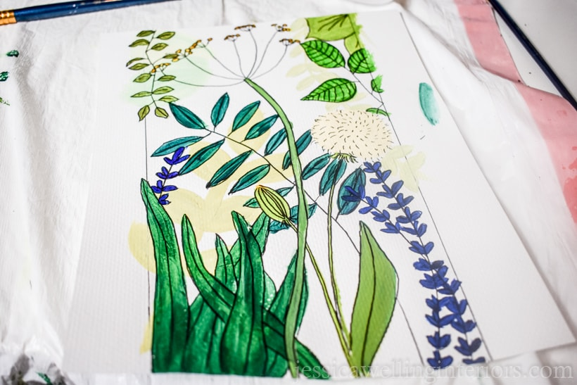 hand-painted botanical wall mural plan drawn and painted on a piece of paper with greens, yellow, and blue flowers