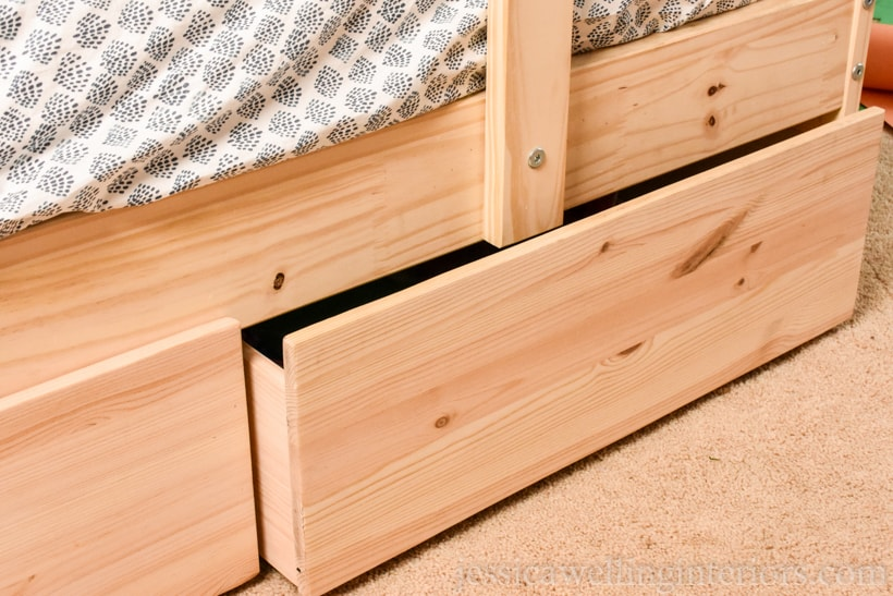 close-up of Ikea bunk bed with hacked under bed storage drawers