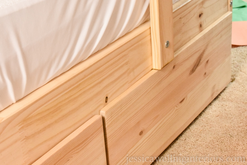 close-up of bottom of IKEA MYDAL bunk bed with under-bed storage hack