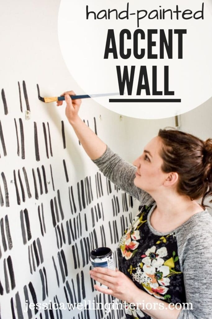 hand-painted accent wall: woman hand-painting an accent wall