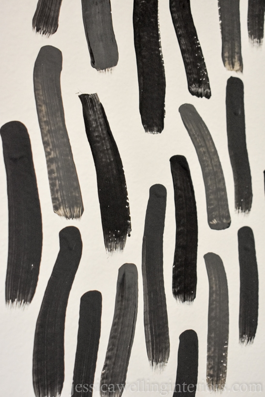 modern accent wall pattern: grey and black brush strokes interlock to create a bold pattern