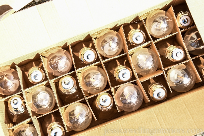box of outdoor string light bulbs, ready to be hung over a deck or patio