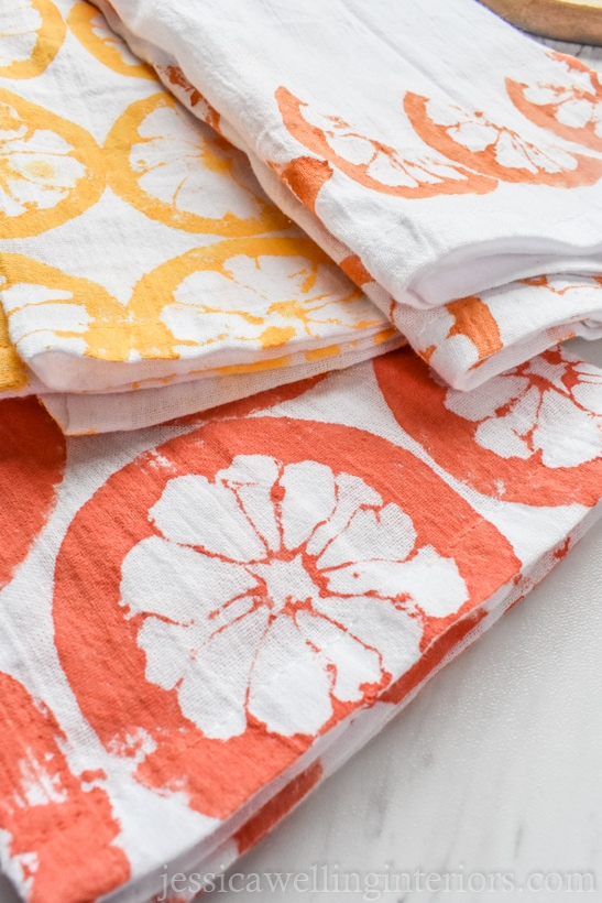 stack of flour sack kitchen towels stamped with fun DIY citrus fruit pattern