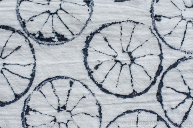 close-up of white tea towel stamped with a lime in navy paint