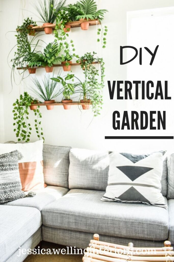 DIY indoor vertical garden: indoor hanging plants on a wall above a sofa with Boho decor