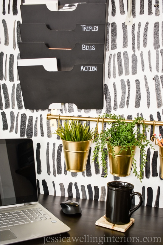 home office with faux plants in pencil cups