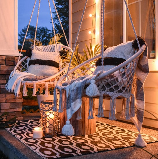 Modern Boho porch with two macrame swings and string lights