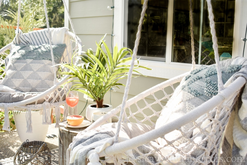 close-up of macrame swings on a porch with cushions and outdoor pillows