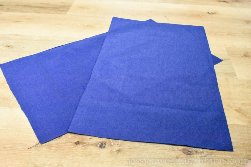 Two rectangles cut from solid blue water-resistant outdoor fabric.