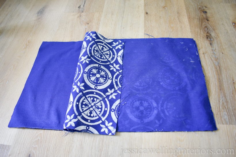 Two rectangles of cobalt blue fabric on laying with right sides together, ready to be pinned