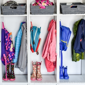 mudroom cubblies Ikea hack with kids backpacks, coats, and rain boots
