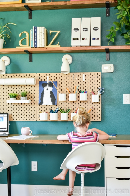 This boho homeschool and distance learning room is full of Ikea hacks and organization ideas on a budget! It includes individual workstations, perfect lighting for Zoom meetings, and much more! It's perfect for older kids and younger kids alike!