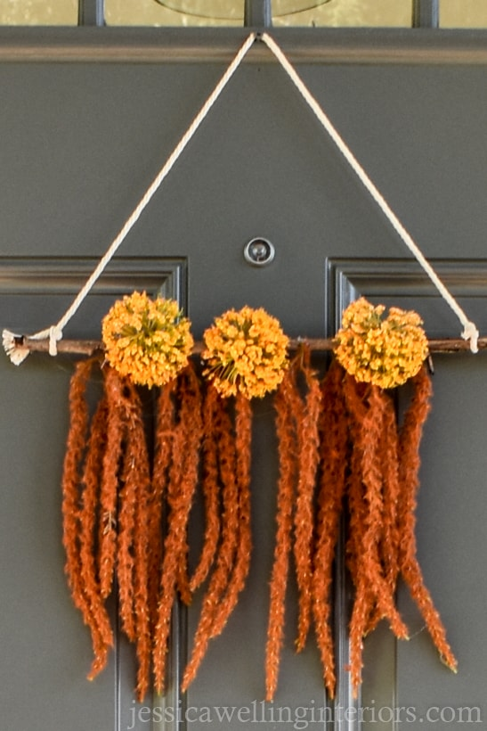 close-up of an easy DIY Boho wreath wall hanging on a front door for Fall