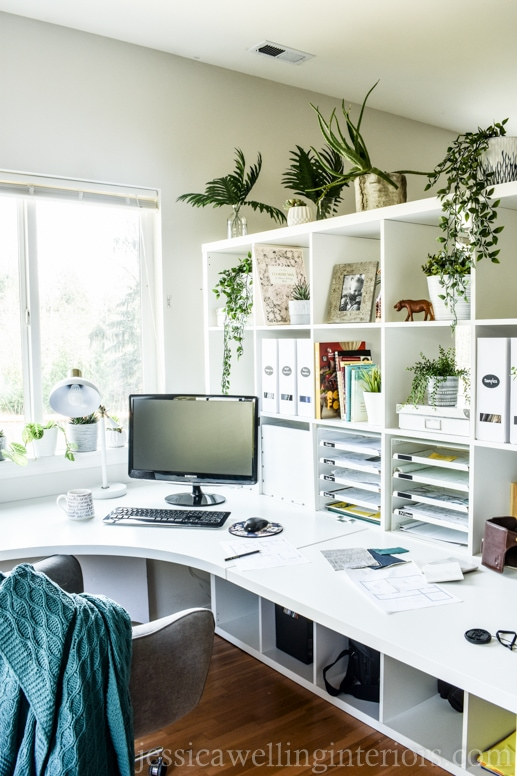 modern Ikea home office with large corner desks and Kallax bookshelf, with magazine files, Kvisssle paper sorters, and lots of indoor plants.