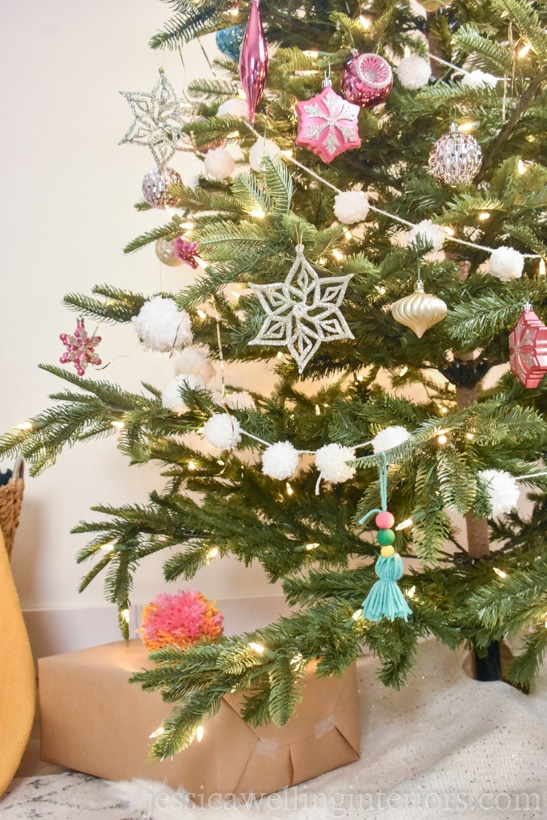 Boho Christmas tree decorated with a yarn pom pom garland