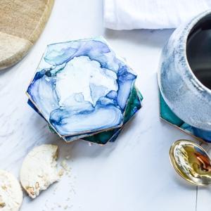 coffee mug and sharpie coasters on a table