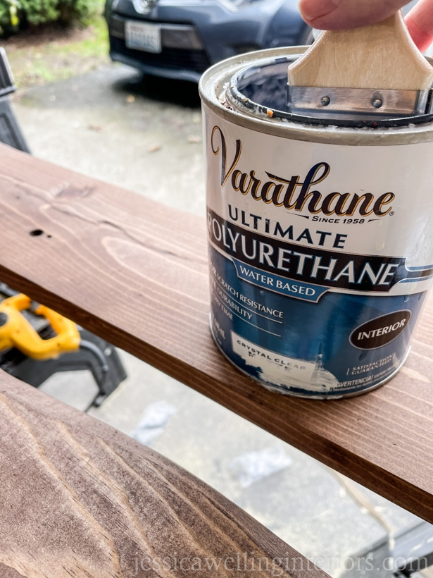 can of polyurethane top coat being applied to a DIY coat rack