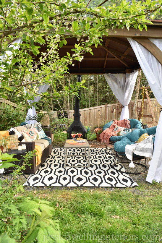 Yardistry gazebo with diy outdoor curtains hanging in the corners