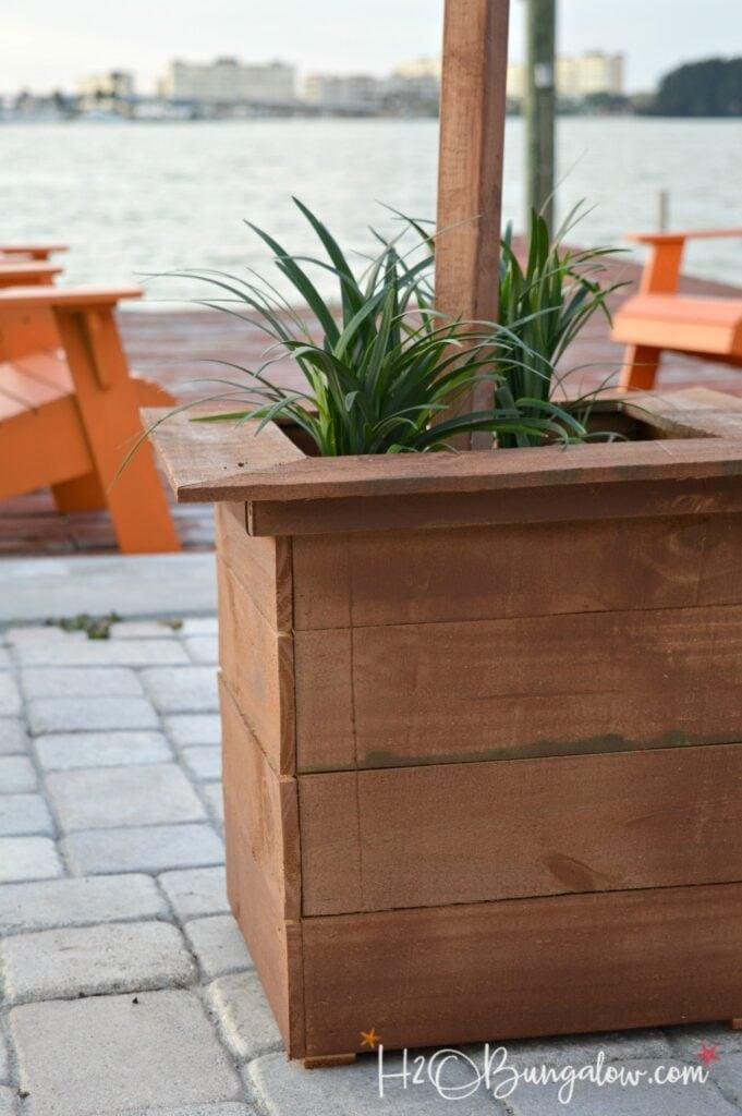 close-up of a DIY planter box string light post