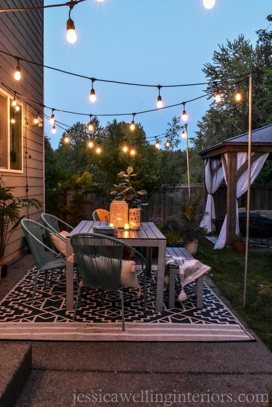 outdoor dining patio with a tribal printed Fab habitat outdoor rug under the table