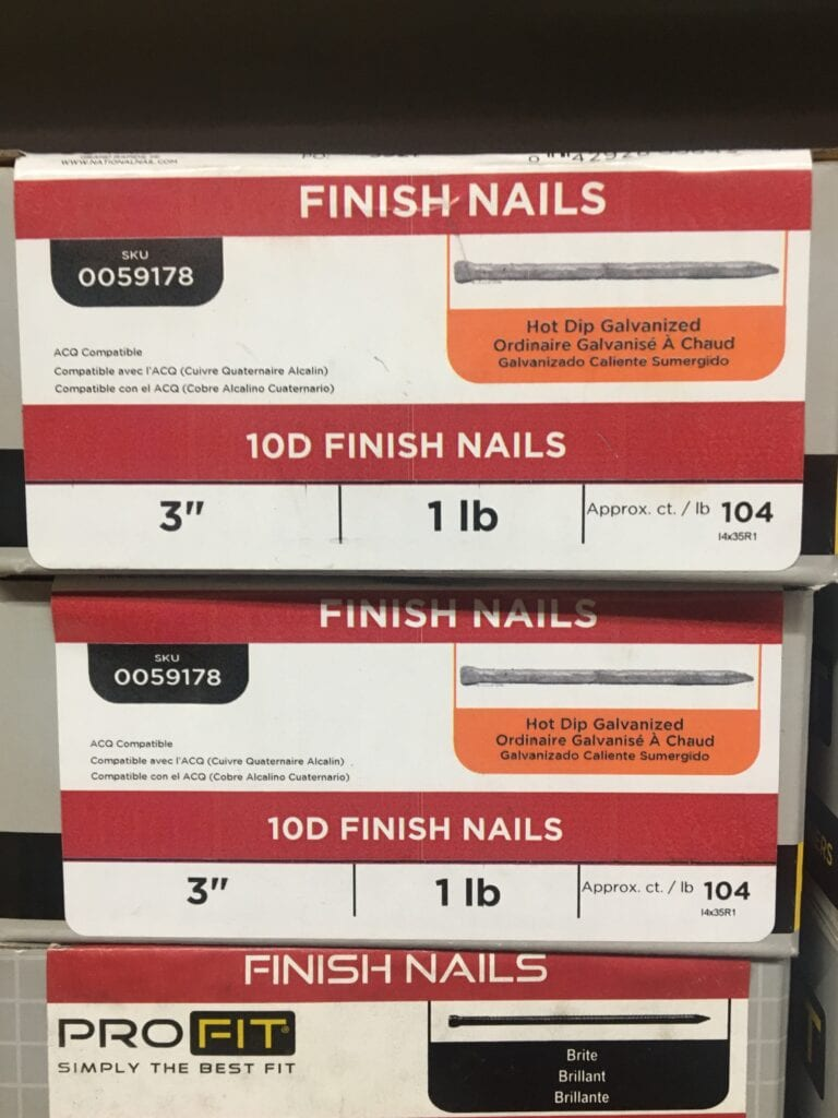"""boxes of 3"""" finish nails stacked at a hardware store"""