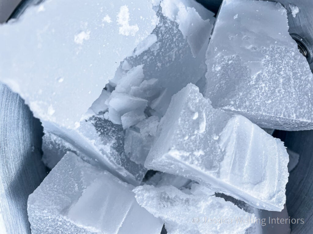close-up of chunks of paraffin wax in a metal pitcher
