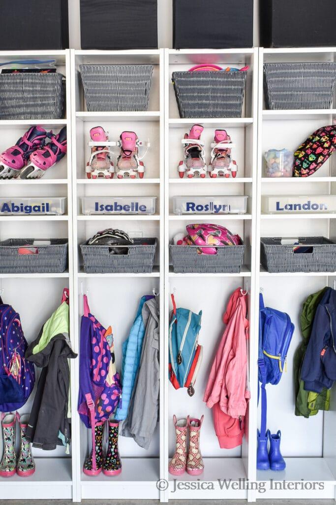 Ikea-hacked mudroom cubbies with coat hooks, shoe bins, etc.