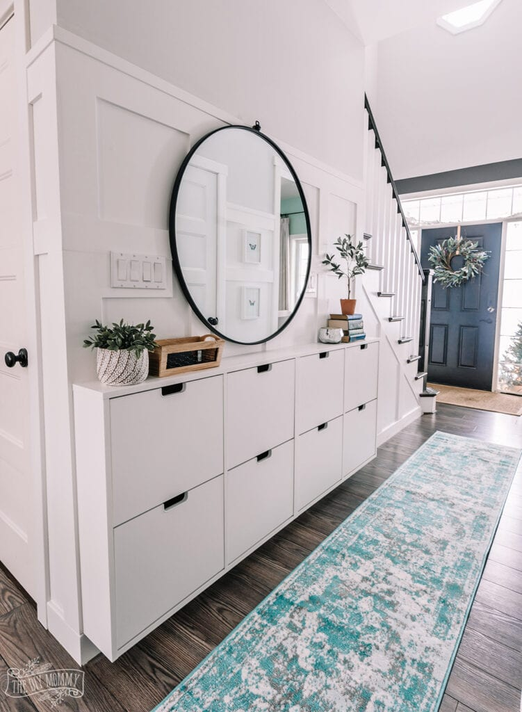 entryway hall with Ikea shoe storage cabinets mounted to the wall