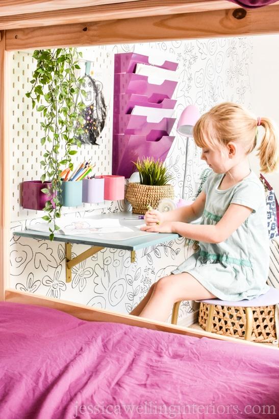 little girl sitting at a DIY floating desk