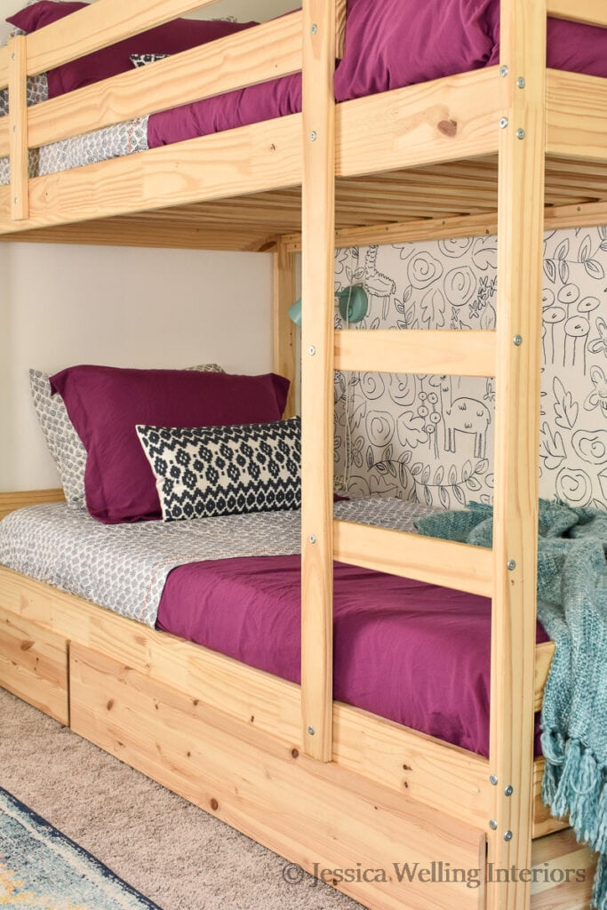Ikea bunk beds with purple comforters and Boho printed sheets