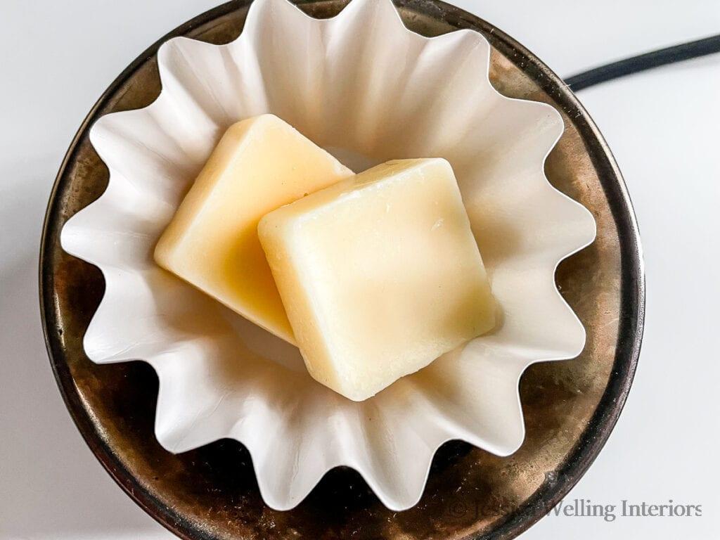 close-up of 2 homemade wax melts in a wax melt warmer