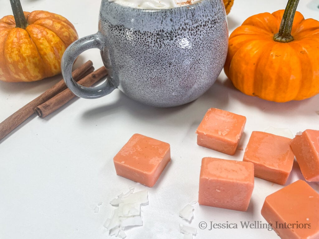 pumpkin spice-scented DIY was melts with pumpkins, a mug of coffee, and cinnamon sticks